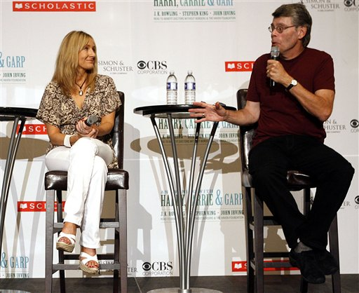 Authors  J.K. Rowling,left, and Stephen King take questions from the media during a press conference Tuesday, Aug 1, 2006, in New York.  The authors are appearing together on August 1 and 2 to read from their books as a fundraiser for Doctors Without Borders and The Haven Foundation.   (AP Photo/Seth Wenig)